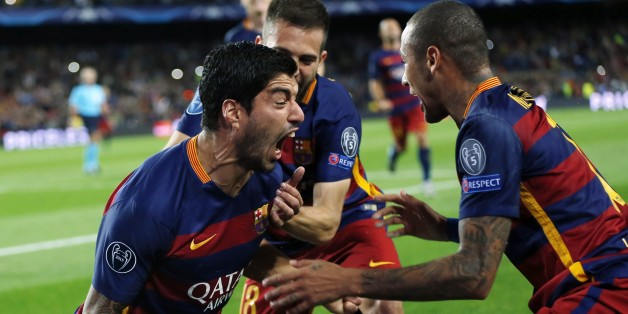 Barcelona's Luis Suarez, left, celebrates with his teammates after scoring the second goal during a Champions League Group E soccer match between Barcelona and Bayer Leverkusen at Camp Nou stadium in Barcelona, Spain, Tuesday, Sept. 29, 2015. (AP Photo/Emilio Morenatti)