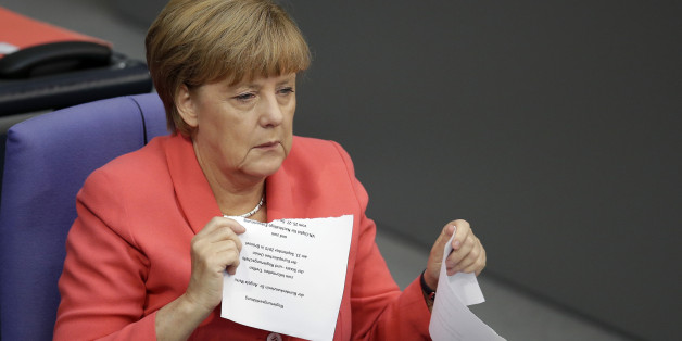 German Chancellor Angela Merkel shreds the script of her speech after she  delivered a government statement as part of a meeting of the German Federal Parliament, Bundestag, at the Reichstag building in Berlin, Germany, Thursday, Sept. 24, 2015. (AP Photo/Michael Sohn)
