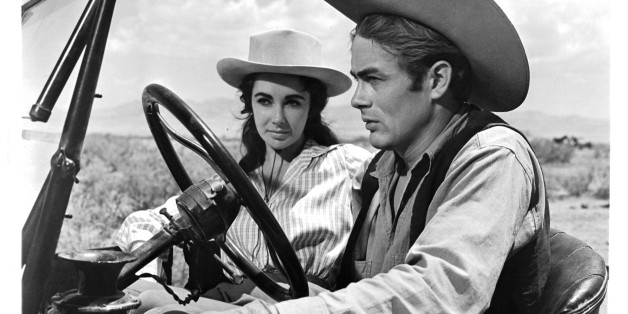 Elizabeth Taylor and James Dean in car together in a scene from the film 'Giant', 1956. (Photo by Warner Brothers/Getty Images)