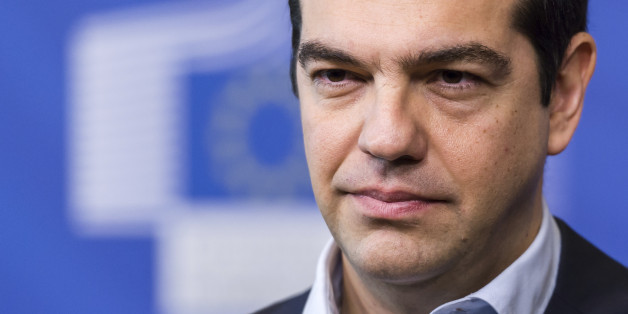Greece's Prime Minister Alexis Tsipras addresses the media at the European Commission headquarters in Brussels Friday, March 13, 2015. (AP Photo/Geert Vanden Wijngaert)