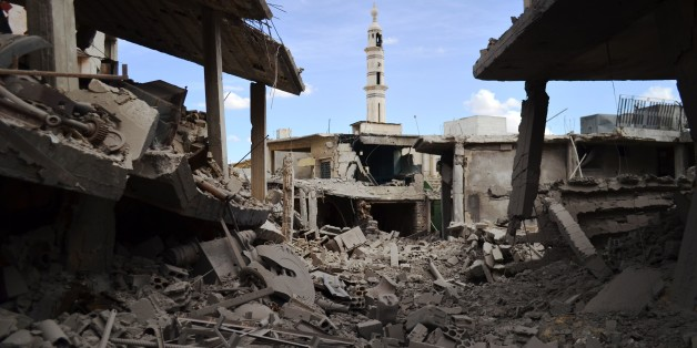 A picture taken on September 30, 2015 shows damaged buildings and a minaret in the central Syrian town of Talbisseh in the Homs province. Russian warplanes carried out air strikes in three Syrian provinces, including Homs, along with regime aircraft on September 30, according to a Syrian security source. Earlier in the day, the Syrian Observatory for Human Rights, a Britain-based monitor, reported at least 27 civilians had been killed in air strikes in the Homs province, adding that the strikes hit Rastan, Talbisseh and Zaafarani. The other Syrian security source said the Russian strikes had hit Rastan and Talbisseh in the province of Homs. AFP PHOTO / MAHMOUD TAHA        (Photo credit should read MAHMOUD TAHA/AFP/Getty Images)