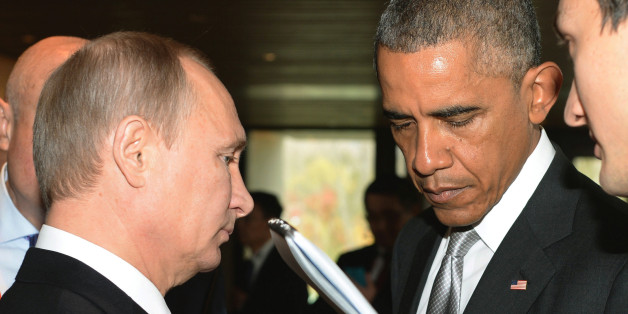 FILE _ This is a Tuesday, Nov. 11, 2014 file photo of Russian President Vladimir Putin, left, and U.S. President Barack Obama, as they talk on the sidelines of the Asia-Pacific Economic Cooperation (APEC) Summit  in Beijing.  Vladimir Putin's spokesman said Thursday Sept. 24, 2015, that  the Russian president will meet with President Barack Obama on Monday. Putin is to speak to the United Nations General Assembly that day. It's not clear whether the meeting with Obama will take place before or a