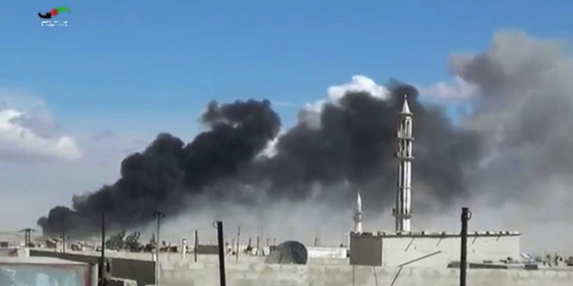 In this image made from video provided by Homs Media Centre, which has been verified and is consistent with other AP reporting, smoke rises after airstrikes by military jets in Talbiseh of the Homs province, western Syria, Wednesday, Sept. 30, 2015. Russian military jets carried out airstrikes in Syria for the first time on Wednesday, targeting what Moscow said were Islamic State positions. U.S. officials and others cast doubt on that claim, saying the Russians appeared to be attacking oppositio