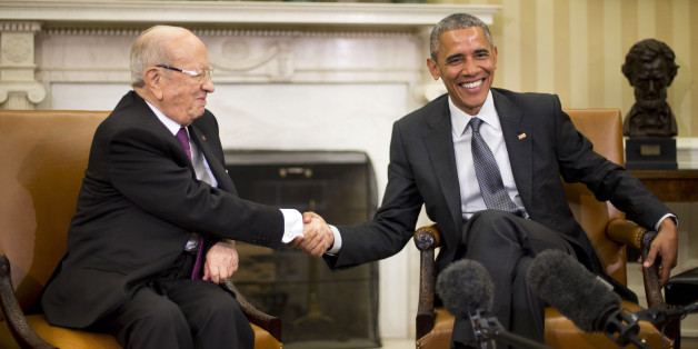 President Barack Obama shakes hands with Tunisian President Beji Caid Essebsi during their meeting in the Oval Office of the White House in Washington, Thursday, May 21, 2015. (AP Photo/Pablo Martinez Monsivais)