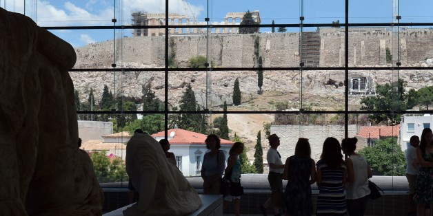 Tourists visit the Acropolis museum  in Athens on July 7, 2015. Eurozone leaders will hold an emergency summit in Brussels on July 7 to discuss the fallout from Greek voters' defiant 'No' to further austerity measures, with the country's Prime Minister Alexis Tsipras set to unveil new proposals for talks.   AFP PHOTO / LOUISA GOULIAMAKI        (Photo credit should read LOUISA GOULIAMAKI/AFP/Getty Images)