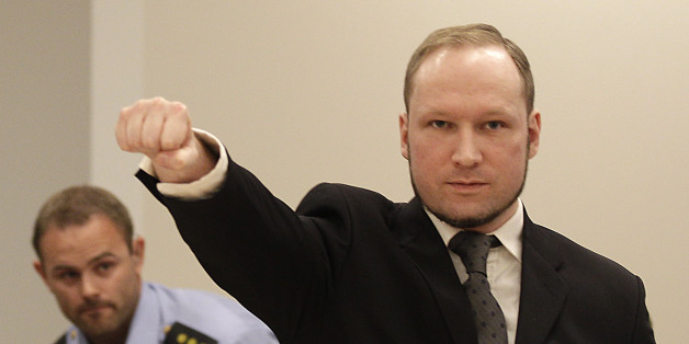 Mass murderer Anders Behring Breivik, makes a salute after  arrives at the court room in a courthouse in Oslo  Friday Aug. 24, 2012 .   Breivik, who admitted killing 77 people in Norway last year, declared sane and sentenced to prison for bomb and gun attacks. (AP Photo/Frank Augstein)