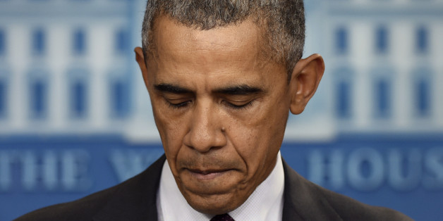 President Barack Obama pauses as he speaks in the Brady Press Briefing Room at the White House in Washington, Thursday, Oct. 1, 2015, about the shooting at the community college in Oregon. The shooting happened at Umpqua Community College in Roseburg, Ore., about 180 miles south of Portland. (AP Photo/Susan Walsh)