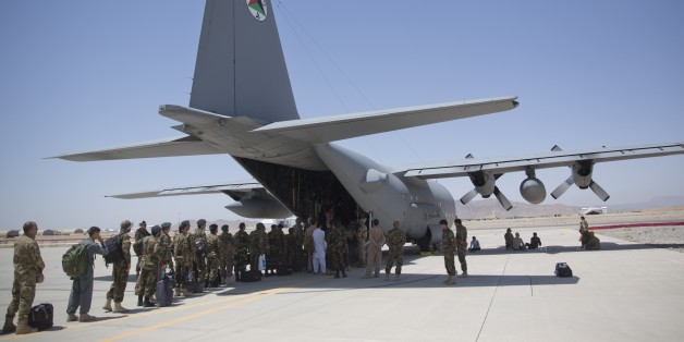 In this Tuesday, Aug. 18, 2015 photo, Afghan National Army soldiers line up to get into a C-130 Hercules, at Kandahar Air Base, in Kandahar, Afghanistan. A series of airports, built by NATO to fight the Taliban, are being handed over to the Afghan government in a civil aviation upgrade that optimists hope will fuel not only regional trade but even tourism. The eight airfields, worth an estimated $2 billion, are scattered around a landlocked and mountainous land whose lack of rail transport or de