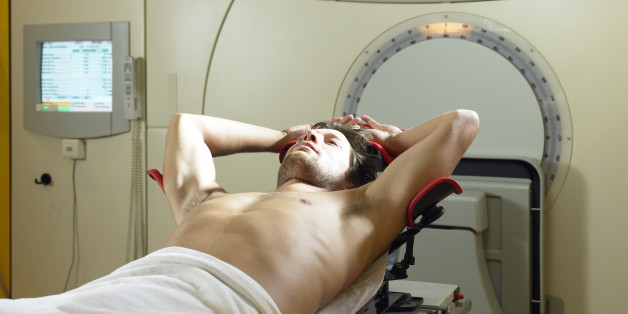 Young male patient lying on radiology bed