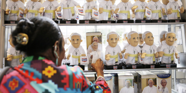 A women shops at the World Meeting of Families souvenir store ahead of Pope Francis' scheduled visit, Tuesday, Sept. 22, 2015, in Philadelphia. The World Meeting of Families which officially opened Tuesday is described by organizers as a conference that blends prayer, religious instruction and faith-themed lectures as the world's largest gathering of Catholic families. (AP Photo/Matt Rourke)