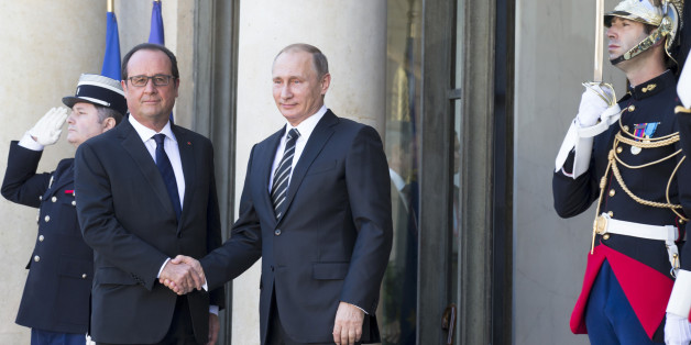 French President Francois Hollande, left, greets his Russian counterpart Vladimir Putin upon his arrival at the Elysee Palace in Paris, France, Friday, Oct. 2, 2015, Russian President Vladimir Putin is meeting the leaders of Ukraine, France and Germany in a revived European push to bring peace to eastern Ukraine. The long-awaited summit in Paris on Friday is being overshadowed by international concerns about Russia's military intervention in Syria this week. (AP Photo/Alexander Zemlianichenko)