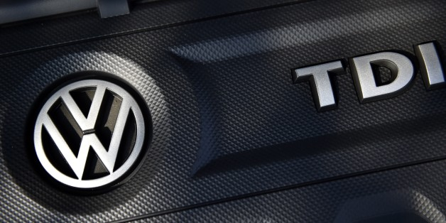 The logo of German car maker Volkswagen (VW) is seen on a VW Golf car in Milton Keynes, north of London, on October 2, 2015. Paris prosecutors have launched a preliminary investigation into possible fraud over the pollution-cheating software installed in diesel engines by German auto giant Volkswagen, a judicial source told AFP on October 2, 2015. AFP PHOTO / FRANCK FIFE        (Photo credit should read FRANCK FIFE/AFP/Getty Images)