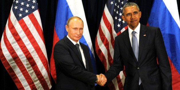 NEW YORK, USA. SEPTEMBER 28,: Russia's President Vladimir Putin (L) and US President Barack Obama shake hands at a meeting after the 70th session of the United Nations General Assembly in New York on September 28, 2015. (Photo by Russian Presidential Press and Information Office/Anadolu Agency/Getty Images)