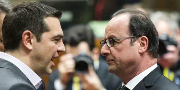 French President Francois Hollande, right, speaks with Greek Prime Minister Alexis Tsipras during a round table meeting at an EU summit in Brussels on Thursday, March 19, 2015. Tensions over Greece's massive financial bailout overshadowed a European Union summit amid fears that the country could accidentally drop out of the euro, triggering a crisis across the currency zone shared by 19 nations. (AP Photo/Geert Vanden Wijngaert)