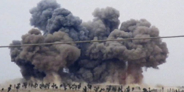 FILE - In this Thursday, Oct. 1, 2015 file image made from video provided by Hadi Al-Abdallah, which has been verified and is consistent with other AP reporting, smoke rises after airstrikes in Kafr Nabel of the Idlib province, western Syria. Russian jets carried out a second day of airstrikes in Syria Thursday, but there were conflicting claims about whether they were targeting Islamic State and al-Qaeda militants or trying to shore up the defenses of President Bashar Assad. (Hadi Al-Abdallah v