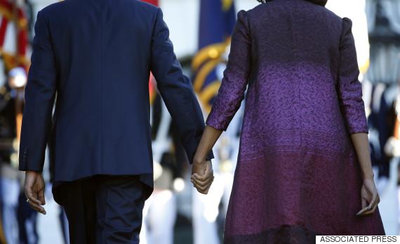 obama barack michelle back hands