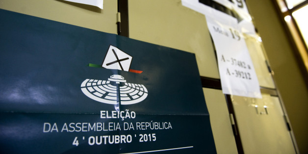 A poster for the national election sits on lockers in a public school used as a polling station during the Portuguese election, in Massama near Lisbon, Portugal, on Sunday, Oct. 4, 2015. Portuguese voters are casting their ballots Sunday in the first general election since 2011, with polls signaling the government that led the nation out of an international bailout may be re-elected. Photographer: Paulo Duarte/Bloomberg via Getty Images