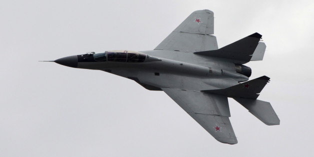 FILE - In this Saturday, Aug. 11, 2012 file photo, a Russian MiG-29 plane flies during a celebration marking the Russian air force's 100th anniversary in Zhukovsky, outside Moscow, Russia. The Syrian air force has destroyed two of three jets seized and reportedly test flown over Aleppo by the Islamic State group last week, according to Omran al-Zoubi, the country's information minister who spoke on Syrian TV late Tuesday, Oct. 21. 2014. Al-Zoubi said that Syrian aircraft bombed the jets as they