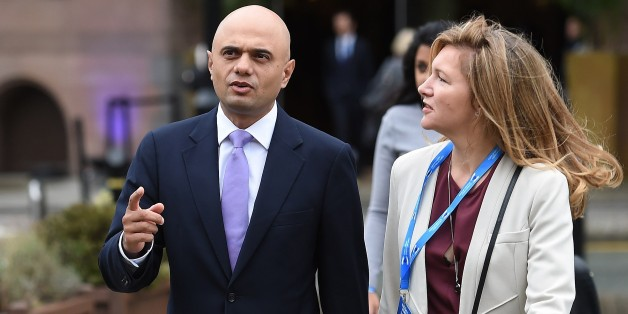 British Secretary of State for Business, Innovation and Skills, Sajid Javid (L) arrives to address delegates on the second day of the annual Conservative party conference in Manchester, north west England, on October 5, 2015. AFP PHOTO / PAUL ELLIS        (Photo credit should read PAUL ELLIS/AFP/Getty Images)