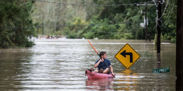 COLUMBIA, SC - OCTOBER 4:   A man kayaks on Tall Pines Circle October 4, 2015 in Columbia, South Carolina. South Carolina experiencied a record rainfall, with at leasrt 11.5 inches falling October 3.  (Photo by Sean Rayford/Getty Images)