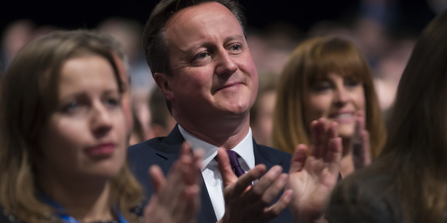 British Prime Minister David Cameron applauds after listening to a speech by Chancellor of the Exchequer George Osborne, during the Conservative Party Conference, in Manchester, England, Monday Oct. 5, 2015. The ruling Conservative Party continue their annual conference on Monday, seemingly buoyant after their electoral triumph in May. (AP Photo/Jon Super)
