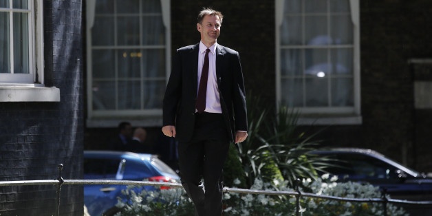 Jeremy Hunt, U.K. health secretary, arrives for the first weekly cabinet meeting of the new Conservative government in Downing Street, London, U.K., on Tuesday, May 12, 2015. U.K. Prime Minister David Cameron said London Mayor Boris Johnson will take part in meetings of his new cabinet, as he promoted Amber Rudd and Priti Patel to senior government posts. Photographer: Simon Dawson/Bloomberg via Getty Images