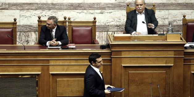 Greek Prime Minister Alexis Tsipras attends a swearing-in ceremony of the new deputies that were elected in the September 20 general elections, at the Greek parliament  in Athens on October 3, 2015.   AFP PHOTO/ LOUISA GOULIAMAKI        (Photo credit should read LOUISA GOULIAMAKI/AFP/Getty Images)