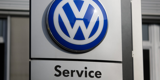 The VW sign of Germany's car company Volkswagen is displayed at the building of a compsny's retailer in, Berlin, Germany, Monday, Oct. 5, 2015. (AP Photo/Markus Schreiber)