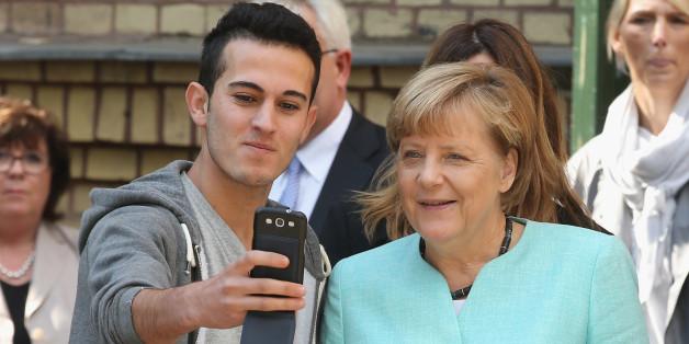 Angela Merkel beim Besuch einer Flüchtlingsunterkunft.