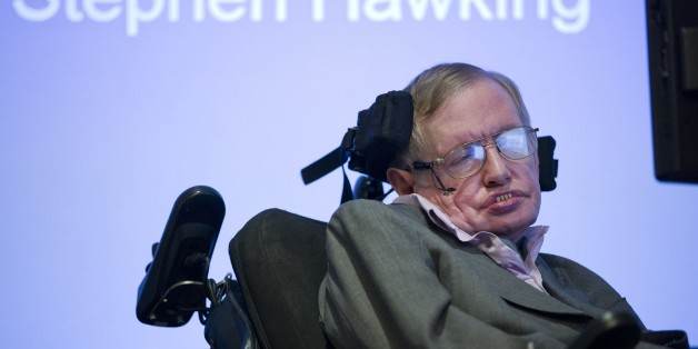 British theoretical physicist professor Stephen Hawking speaks to members of the media at a press conference in London on December 2, 2014. The system that helps Stephen Hawking communicate with the outside world will be made available online from January in a move that could help millions of motor neurone disease sufferers, scientists said Tuesday. The wheelchair-bound theoretical physicist, who shot to international fame in the 1980s with his book 'A Brief History of Time', hailed the decision by US tech giant Intel at a press conference in London. AFP PHOTO / JUSTIN TALLIS        (Photo credit should read JUSTIN TALLIS/AFP/Getty Images)