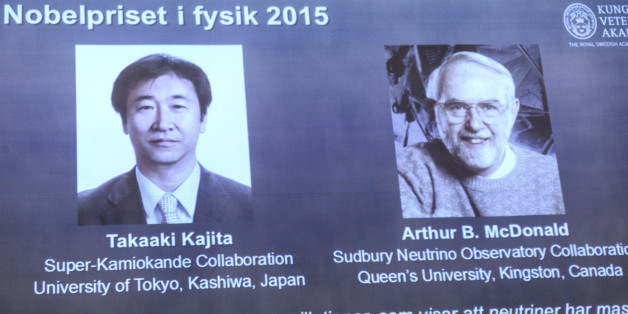 A screen shows the winners as members of the Nobel Assembly announce the winner of the 2015 Nobel Prize in physics, in Stockholm, Tuesday Oct. 6, 2015. Takaaki Kajita of Japan and Arthur McDonald of Canada won the Nobel Prize in physics for the discovery of neutrino oscillations. The Royal Swedish Academy of Sciences said the two researchers had made key contributions to experiments showing that neutrinos change identities. (Fredrik Sandberg/TT via AP) SWEDEN OUT
