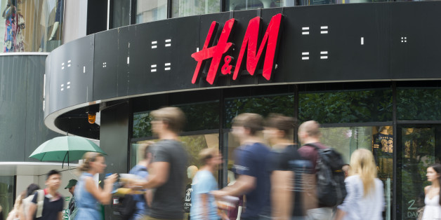 Frankfurt, Germany - August 14: People pass by a branch of H+M ( H&M, Hennes and Mauritz ) department store on August 14, 2015 in Frankfurt, Germany. (Photo by Michael Gottschalk/Photothek via Getty Images)
