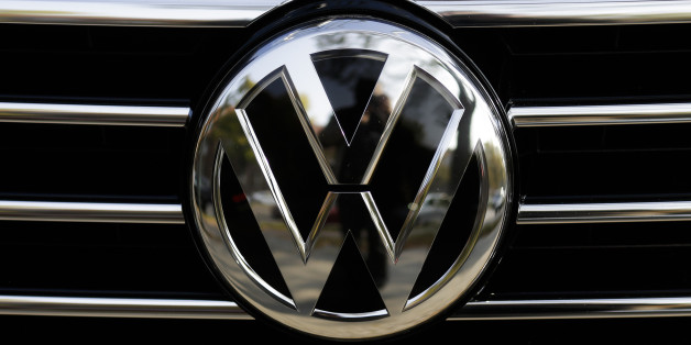 The VW sign of Germany's car company Volkswagen at the radiator grill of a VW car photographed in, Berlin, Germany, Monday, Oct. 5, 2015. (AP Photo/Markus Schreiber)