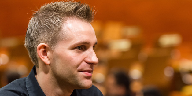Austria's Max Schrems listens to a ruling at the European Court of Justice in Luxembourg on Tuesday, Oct. 6, 2015. Europe's highest court has ruled in favor of an Austrian law student who claims a trans-Atlantic data protection agreement doesn't adequately protect consumers. (Geert Vanden Wijngaert)