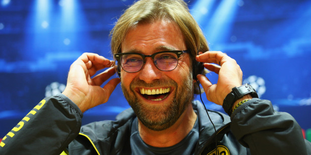 Jurgen Klopp manager of Borussia Dortmund laughs during a Borussia Dortmund press conference, ahead of the UEFA Champions League Group D match against Arsenal, at Emirates Stadium on November 25, 2014 in London, England.  (Photo by Ian Walton/Getty Images)