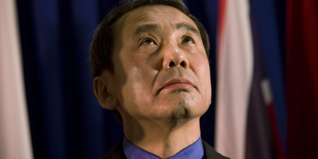 """FILE - In this Feb. 15, 2009 file photo, novelist Haruki Murakami of Japan reacts before receiving the Jerusalem award during the International Book Fair in Jerusalem. Murakami said Monday, May 6, 2013 his latest novel was a new experiment and grew longer than expected as he developed a desire to expand on side characters while writing. The latest novel by one of Japan's most respected and popular novelists, """"Colorless Tsukuru Tazaki and the Year of His Pilgrimage,"""" has sold more than 1 million"""