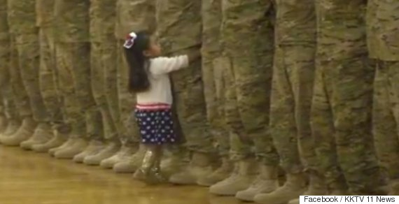girl hug solider dad