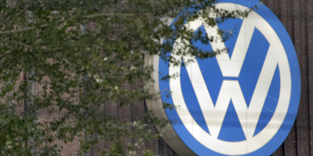 Trees stand in front of giant logo of the German car manufacturer Volkswagen in Wolfsburg, Germany, Saturday, Sept. 26, 2015. (AP Photo/Michael Sohn)