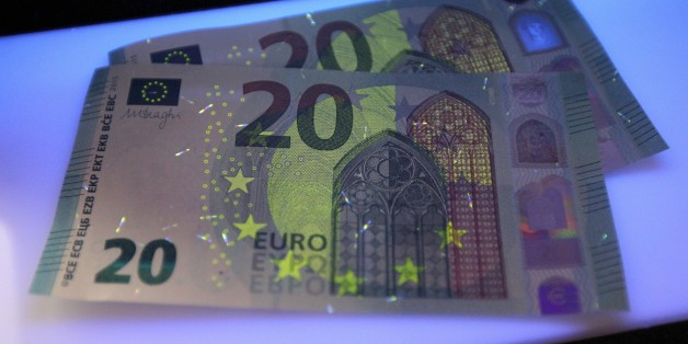 New 20 Euro notes are seen in Frankfurt am Main, western Germany, on March 4, 2015. According to the German Central Bank Bundesbank, the new banknote containing an additional innovative security feature, the portrait window in the hologram, will be issued for retailers and consumers on November 25, 2015.     AFP PHOTO / DANIEL ROLAND        (Photo credit should read DANIEL ROLAND/AFP/Getty Images)