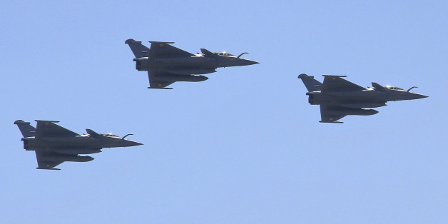 Three French made Rafale fighter jets fly in formation above Cairo, on Tuesday, July 21, 2015. Egypt took delivery of three Rafale fighter jets from France, the first of 24 warplanes purchased as part of a nearly $6 billion deal that also included an advanced frigate and munitions. (AP Photo/Ahmed Abd El Latif)