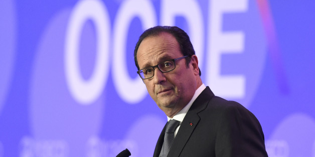 "French President François Hollande delivers remarks on ""Investment and Climate"" during the OECD Ministerial Council meeting at the OECD headquarters in Paris, France, Wednesday, June 3, 2015. The world economy risks being bogged down in a low growth spiral unless measures are taken to spur demand and incite businesses to boost their stubbornly sluggish investments. That's the conclusion of the latest economic forecast from the Organization for Economic Cooperation and Development, the Paris-based body made up of 34 of the world's most developed countries. (Alain Jocard/Pool Photo via AP)"