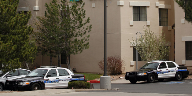 Flagstaff, Ariz., police cars stand Tuesday, May 1, 2012, outside the hotel where Norway's world champion swimmer Alexander Dale Oen was found collapsed on the floor of his bathroom late Monday. Oen, 26, the 100-meter breaststroke world champion, was pronounced dead at Flagstaff Medical Center. Oen was in Flagstaff to train at the Wall Aquatic Center on the campus of Northern Arizona University. (AP Photo/Matt York)
