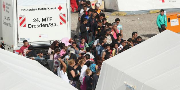 Flüchtlinge kommen in einer Asylunterkunft an (Symbolbild)