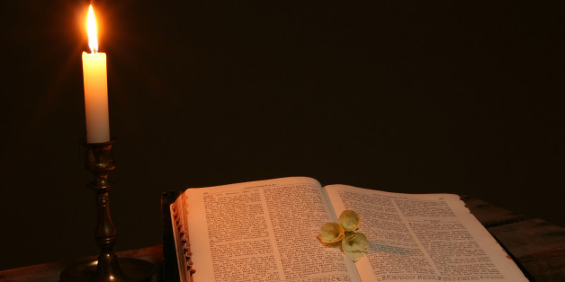 bible prayer book candle