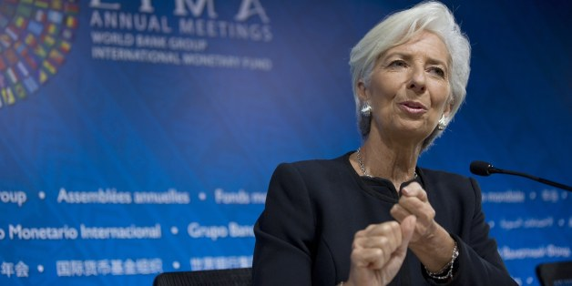 International Monetary Fund chief Christine Lagarde answers a question during a press conference, in Lima, Peru, Thursday, Oct. 8, 2015. The world's finance ministers and central bankers are in Lima for the joint annual meetings of the World Bank and IMF that run through Sunday. (AP Photo/Rodrigo Abd)