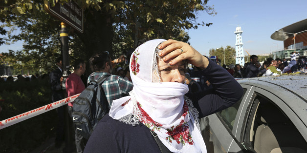 A woman reacts at the site of an explosion in Ankara, Turkey, Saturday, Oct. 10, 2015. Two bomb explosions apparently targeting a peace rally in Turkey's capital Ankara on Saturday has killed over a dozen people, a news agency and witnesses said. The explosions occurred minutes apart near Ankara's train station as people gathered for the rally organized by the country's public sector workers' trade union.(AP Photo/Burhan Ozbilici)