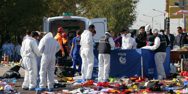 Rescue workers and police forensic officers inspect the site of an explosion in Ankara, Turkey, Saturday, Oct. 10, 2015. Two nearly simultaneous explosions targeted a Turkish peace rally Saturday by Kurdish activists and opposition supporters in Ankara. At least 86 people were killed and nearly 190 wounded in what appeared to be suicide attacks, Turkish officials said. The explosions occurred seconds apart outside the capital's main train station as hundreds gathered for the rally, organize