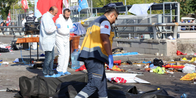 Rescue workers and police forensic officers at the site of an explosion in Ankara, Turkey, Saturday, Oct. 10, 2015. Two nearly simultaneous explosions targeted a Turkish peace rally Saturday by Kurdish activists and opposition supporters in Ankara. At least 86 people were killed and nearly 190 wounded in what appeared to be suicide attacks, Turkish officials said. The explosions occurred seconds apart outside the capital's main train station as hundreds gathered for the rally, organized by Turkey's public workers' union and other civic society groups.The rally aimed to call for increased democracy and an end to the renewed violence between Kurdish rebels and Turkish security forces.(AP Photo/Burhan Ozbilici)   TURKEY OUT