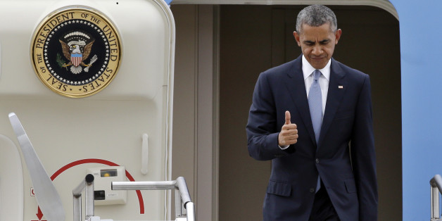 President Barack Obama gives a brief thumbs-up sign as he arrives Friday, Oct. 9, 2015, at King County Airport in Seattle. Obama was in town to attend a pair of fundraisers, following a stop Roseburg, Ore., where he visited families of victims of the shooting rampage there last week. (AP Photo/Elaine Thompson)