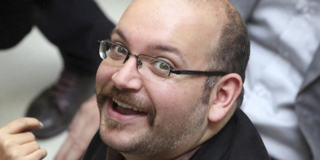 FILE - In this photo April 11, 2013 file photo, Jason Rezaian, an Iranian-American correspondent for the Washington Post, smiles as he attends a presidential campaign of President Hassan Rouhani in Tehran, Iran. Iran's official IRNA news agency reported that the verdict against Rezaian has been issued. Rezaian, the Post's Tehran bureau chief, is accused of charges including espionage in a closed-door trial that has been widely criticized by the U.S. government and press freedom organizations. (A